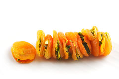 Dried Apricots stuffed sliced pistachios are a popular delicacy Stock Images