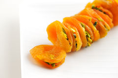 Dried Apricots stuffed sliced pistachios are a popular delicacy Royalty Free Stock Images