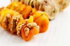 Dried Apricots stuffed with walnuts and dried figs stuffed with sliced pistachios Stock Photography