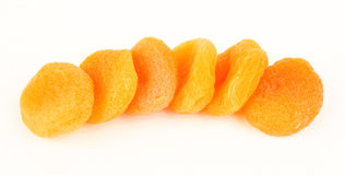 Dried apricots on white Stock Images