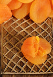 Dried apricots on wood box Royalty Free Stock Images