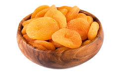 Dried apricots in a wooden bowl. Closeup. Stock Photography