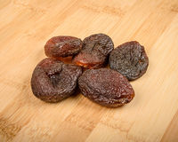 Dried apricots. On a wooden cutting board Royalty Free Stock Photography