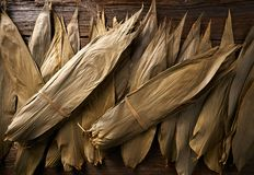 Dried Bamboo leaves in brown for Zongzi recipe. Dried Bamboo leaves in brown for Zongzi asian recipe preparation Royalty Free Stock Images