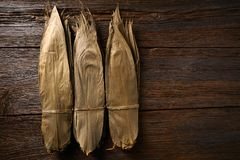 Dried Bamboo leaves in brown for Zongzi recipe. Dried Bamboo leaves in brown for Zongzi asian recipe preparation Royalty Free Stock Photo