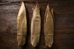 Dried Bamboo leaves in brown for Zongzi recipe. Dried Bamboo leaves in brown for Zongzi asian recipe preparation Royalty Free Stock Photos