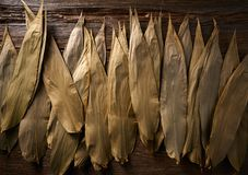 Dried Bamboo leaves in brown for Zongzi recipe. Dried Bamboo leaves in brown for Zongzi asian recipe preparation Stock Photo