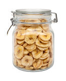 Dried Banana Chips in a Glass Canister Royalty Free Stock Photos