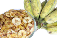 Dried banana slice coated with sugar and salt in cup and a bunch of banana Royalty Free Stock Image