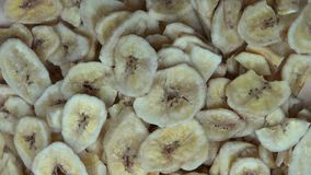 Dried banana slices. clockwise turntable stock video footage