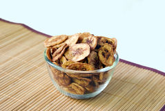 Dried banana slices coated with sugar. The dried banana slices coated with sugar in glass bowl Stock Photos