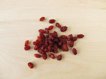 Dried barberries. On wooden board Royalty Free Stock Photography
