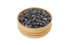 Dried barberry berries in a wooden bowl Royalty Free Stock Images