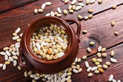 Dried beans on a wooden table Royalty Free Stock Photography