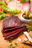 Dried beef meat. On wooden cutting board Stock Photography