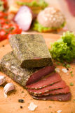 Dried beef meat. Rolled in herbs Stock Images