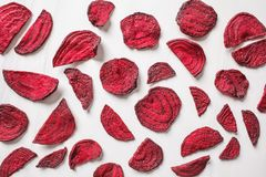 Dried beet chips on a white background, top view stock photos
