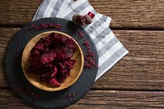 Dried beetroot in wooden plate. Overhead of dried beetroot in wooden plate vector illustration