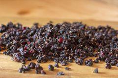 Dried berries of currants and dried blueberries on a wooden table. Ecologically clean food. Healthy dried berries of blueberries a. Nd currants royalty free stock photo