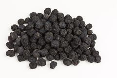 Heap of dried aronia berries. Dried black aronia berries - aronia arbutifolia Royalty Free Stock Photos