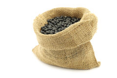 Dried black beans in a burlap bag Royalty Free Stock Photography