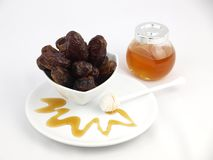 Dried black dates with honey Stock Images