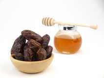 Dried black dates with honey Royalty Free Stock Photography