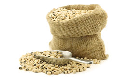 Dried black eyed peas in a burlap bag Stock Photo