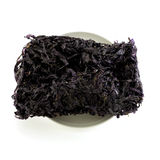 Dried black seaweed close up Isolated. On white background Stock Image