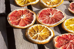Dried blood, grape and orange. Dried red, blood, grape and yellow orange, on wooden background Royalty Free Stock Images