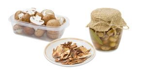 Dried boletus, pickled and fresh uncooked button mushrooms Royalty Free Stock Image