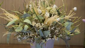 Bouquet with dried flowers for sale. Assortment of flower shop for decoration and congratulation.
