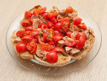 Dried bread called freselle with tuna and tomatoes Royalty Free Stock Photography