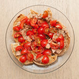 Dried bread called freselle with tuna and tomatoes Stock Photo