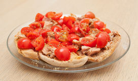 Dried bread called freselle with tuna and tomatoes Stock Photos