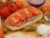Dried bread Friselle or Freselle on wooden board stock photos
