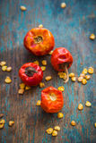 Dried Button Red Chilies. Vertical image of dried button red chilies on a wooden base. Red chili over the top stock image Royalty Free Stock Image