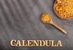 Dried calendula flowers - Calendula officinalis. Top view royalty free stock photo