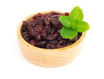 Dried canberry mix blueberry fruit in wood bowl isolated on white backgroud, food healty diet. Dried canberry mix blueberry fruit in wood bowl isolated on white stock images