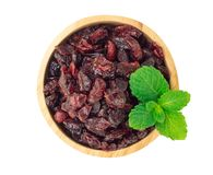 Dried canberry mix blueberry fruit in wood bowl isolated on white backgroud, food healty diet. Dried canberry mix blueberry fruit in wood bowl isolated on white stock photography