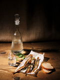 Dried capelin with glass of vodka and bread Stock Photos