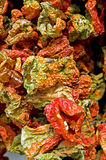 Dried capsicums on a market stall. Dried capsicums hanging on a market stall Stock Photography