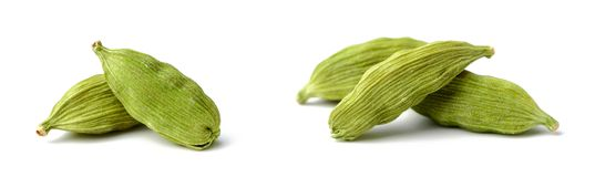 Dried cardamom seeds on white. Background stock image