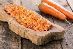 Dried carrots in wooden bowl stock photo