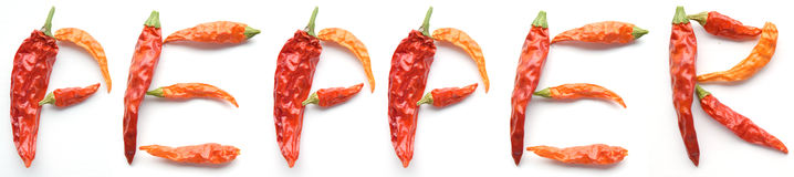 Dried cayenne chili peppers alphabet Stock Image