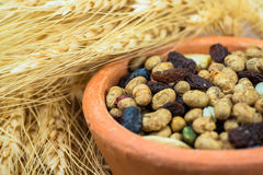 Dried cereal seeds and fruits with stalks of wheat ears Stock Photos