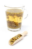 Dried chamomile and cup of beverage Stock Photography