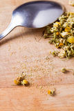 Dried chamomile flowers with spoon Stock Photos