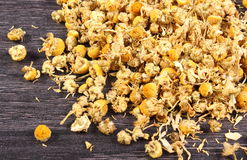 Dried chamomile on wooden table, alternative medicine Royalty Free Stock Photography