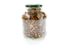 Dried chanterelle mushrooms in a jar Stock Image